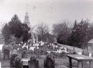 Early twentieth century photograph of the Ancient Burying Ground and First Church of Christ.